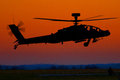 A british army ah apache helicopter comes in to take fuel in the late eveneing light Royalty Free Stock Photo