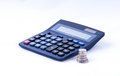 British coins and calculator stacked along with digital digit on white background studio shot Royalty Free Stock Images