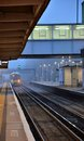 British commuter train pulling into suburban railway station a regional bromley south kent in early morning fog Stock Images