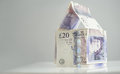 British currency property investment a house made of twenty pound notes Royalty Free Stock Photos