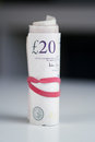 British currency a roll of twenty pound notes on a table Royalty Free Stock Photos