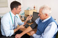 British Doctor Taking Senior M...