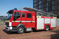 British fire engine parked red with removed logos Royalty Free Stock Photos