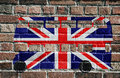 British flag double decker bus on brick wall Royalty Free Stock Photography