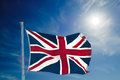 British flag and pole union jack flying high against blue sky with copy space Royalty Free Stock Photos