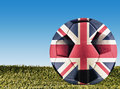 British football a over grass decorated with uk flag Stock Images