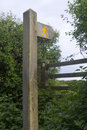 British footpath sign, stile and waymarker. Royalty Free Stock Photo