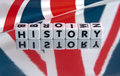 British history text in uppercase black letters on small white cubes on reflective surface with union jack flag superposed Stock Photography