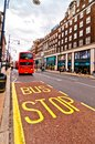 British icon double decker bus along oxford street in london uk april on april is europe s busiest shopping Royalty Free Stock Image