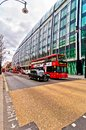 British icons double decker bus and taxi along oxford street in london uk april on april is europe s busiest Royalty Free Stock Photos