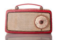 British made sixties transistor radio red body with brass grille on white Royalty Free Stock Photography
