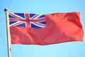 British maritime red ensign flag blue sky the uk the flown from a yacht sail boat Stock Photography