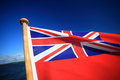 British maritime red ensign flag blue sky the uk the flown from a yacht sail boat and sea Royalty Free Stock Photos