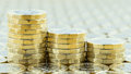 British money, three pound coins descending stacks. Royalty Free Stock Photo