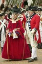 British officer and lady in red dress Stock Photos