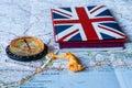 British passport with compass lying Royalty Free Stock Photo