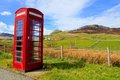 British phone booth in the country classic red countryside of isle of skye scotland Royalty Free Stock Images