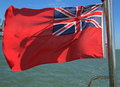 British red ensign the uk as flown by merchant shipping and civil registered vessels flying from a yacht Stock Image