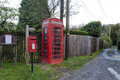 British red telephone box and post box a typical view of a countryside landscape with ubiquitous Stock Images