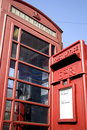 A British red telephone box and red post box Stock Photo