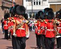 British royal guards marching from regimental band at changing of the guard by st james s palace in london england Royalty Free Stock Photo