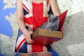 British shorthair baby girl holding a kitten in a book box map on the background and union jack t shirt Royalty Free Stock Images