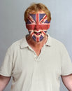British supporter hysterical with the flag painted on his face Stock Image