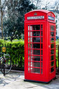 British telecoms telephone box near a park in london vintage red Royalty Free Stock Photos
