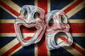 British theatre english performing arts concept old flag britain comedy tragedy mask representing rich cultural tradition Royalty Free Stock Images