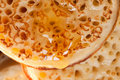 British toasted crumpet with honey Royalty Free Stock Photo