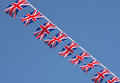 British union jack bunting flags against blue sky Stock Photos