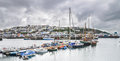 Brixham harbour from the sea on a boat on a cloudy day Stock Photos