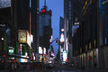 Broadway at dusk shows neon lights, New York, USA
