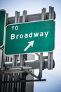 Broadway sign road giving directions to the famous avenue in new york city Royalty Free Stock Photo