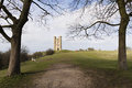 Broadway tower cotswolds uk is a folly located on hill near the village of in the the image is framed by Royalty Free Stock Photo