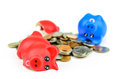 Broaken piggybank with coins Royalty Free Stock Photo