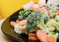 Broccoli, carrots, frozen vegetables on a plate Royalty Free Stock Photo