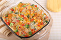 Broccoli and chicken casserole with red pepper cheese in a baking dish Stock Photography