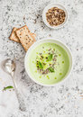 Broccoli cream soup with flax seeds and crackers on a light background Royalty Free Stock Photo