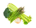 Broccoli florets asparagus onion celery top a view of a combination of and on white Royalty Free Stock Photography