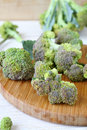 Broccoli florets on a cutting board close up Stock Photography