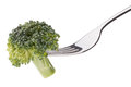 Broccoli on fork isolated on white background cutout. Healthy ea
