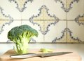 Broccoli with kitchen knife close up on wooden cutting board Stock Image