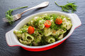 Broccoli pasta (shell shape) with dill and spices in baking dish Royalty Free Stock Photo
