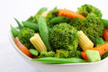 Broccoli salad with carrot ,baby corn and snap pea Stock Photos