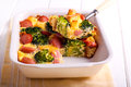 Broccoli and sausage bake in a tin Royalty Free Stock Images