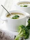 Broccoli soup on bowl over wood Stock Photography