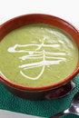 Broccoli soup in brown bowl on green napkin with a spoon Royalty Free Stock Photography