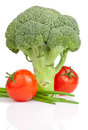 Broccoli, Two Tomato and Fresh Scallions Isolated Stock Photos