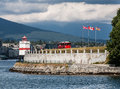 Brockton point lighthouse stanley park the white red and black in stanely vancouver british columbia canada at the shore of the Royalty Free Stock Photography
